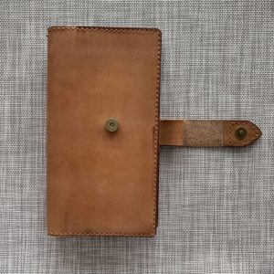 Travelers' Notebook cover with magnetic clasp closure and back pocket